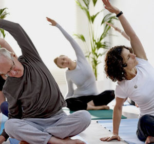 adults in a yoga class